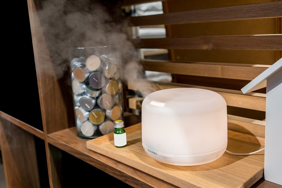 essential oil diffuser on woodern board