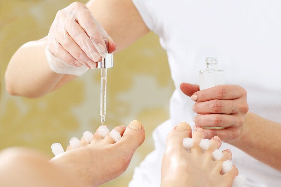 putting oil on toes
