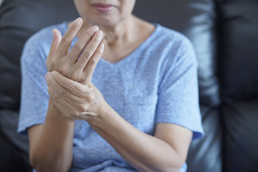 woman with arthritis in hand